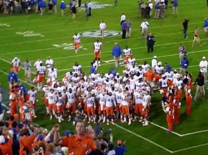 Post-game Gator team cheer along with the band and the fans